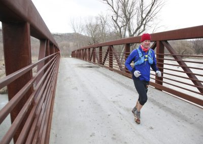 100 Miler Kevin Langton Crossing the Zumbro River - Photo Credit Eric Hadtrath