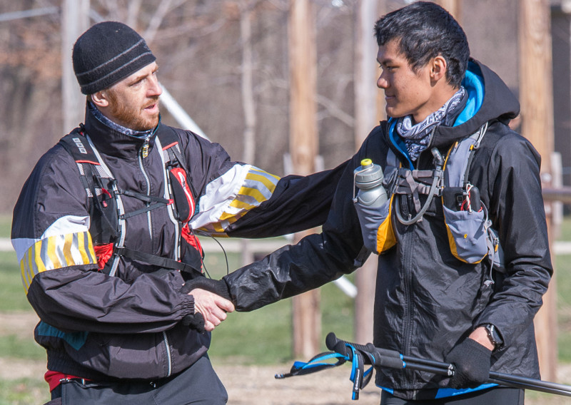 17 Year Old 100 Mile Finisher Kevin Chem Thanks His Pacer - Photo Credit Todd Rowe